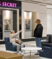 Elderly woman appears to tell off older man inside a mall.