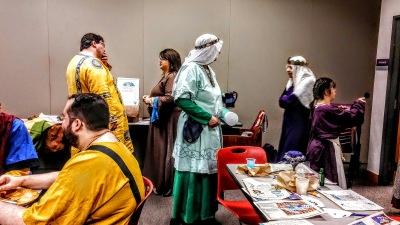 Medieval attired people talking.